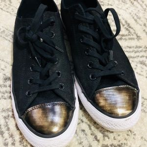 Converse sneakers. Black and gold metallic.